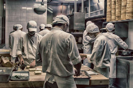 culinary tourism: Chinese chefs prepare Dim sum dumplings food at Restaurant in Hong Kong, China.