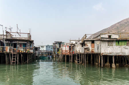 lantau: Hong Kong, China - November 30, 2015: Houses on stilts above the tidal flats of Lantau Island are homes to the Tanka people in Tai O, Hong Kong. These unusual structures are interconnected, forming a tightly knit fishing community that literally lives on