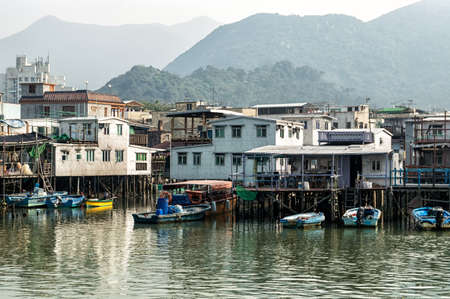 above 30: Hong Kong, China - November 30, 2015: Houses on stilts above the tidal flats of Lantau Island are homes to the Tanka people in Tai O, Hong Kong. These unusual structures are interconnected, forming a tightly knit fishing community that literally lives on