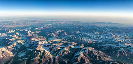 extreme angle: Himalayian Mountain range from the air. Stock Photo