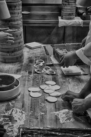 sums: Chinese Chefs Preparing vegetable dim sums chinese dumplings