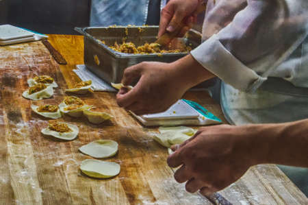 Chinese Chefs Preparing vegetable dim sums chinese dumplings