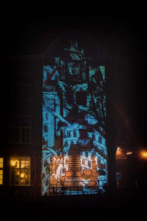 amsterdam canal: Amsterdam, the Netherlands January 8, 2016: artwork called Canal House from Irma de Vries exhibited at Amsterdam Light Festival 2015 which is dedicated to theme Friendship