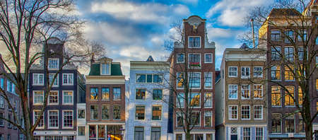 The facades of a row of beautiful Amsterdam canal houses.