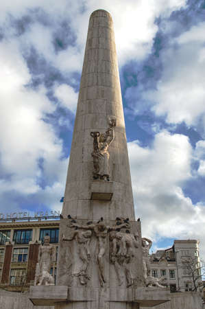 dam square: Amsterdam, Netherlands - January 08, 2016: Detail from the National Monument on Dam Square in central Amsterdam. The relief seen here on the front of the monument is entitled De Vrede (Peace), and represents the suffering endured during the war. Stock Photo