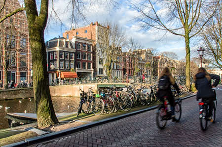 the netherlands: Bikes on the bridge in Amsterdam Netherlands