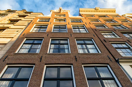 17th: The facades of three 17th century houses from Amsterdam.