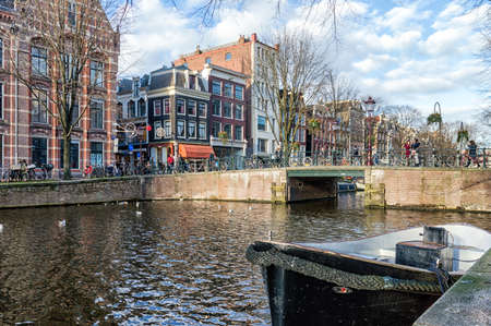 nautical structure: City view of Amsterdam canals and typical houses, boats and bicycles, Holland, Netherlands. Editorial
