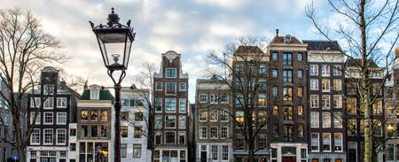 canal houses: The facades of a row of beautiful Amsterdam canal houses.