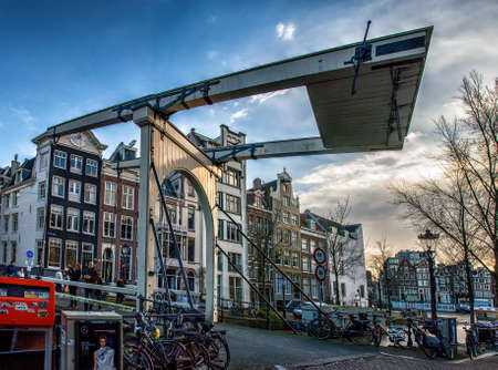drawbridge: a traditional wooden drawbridge that spans a canal in Amsterdam, the Netherlands