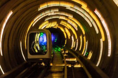 blurred motion: Light show inside Bund sightseeing tunnel blurred motion under the Huangpu River, Shanghai, China.