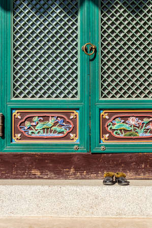 veneration: Shoes in front of buddhist temple. In every buddhist temple you cant get inside in shoes. Seoul, South Korea