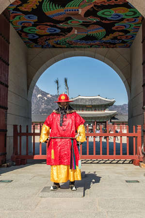 korean ethnicity: Seoul, South Korea - February 6, 2016: Royal Guards at the Gyeongbok Palace also known as Gyeongbokgung Palace. This royal palace is located in northern Seoul. First constructed in 1394 and reconstructed in 1867, it was the main and largest palace of the