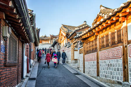 Seoul, South Korea - February 6, 2016: Bukchon Hanok Village is a Korean traditional village, The traditional village is composed of lots of alleys, hanok and is preserved to show a 600-year-old urban environment. Now it is used as a traditional culture c