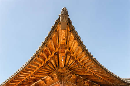 korean style house: The korean traditional building(house) with wood(wooden) roof, Hanok at the korean royal palace(Gyeongbokgung) in the blue sky Stock Photo