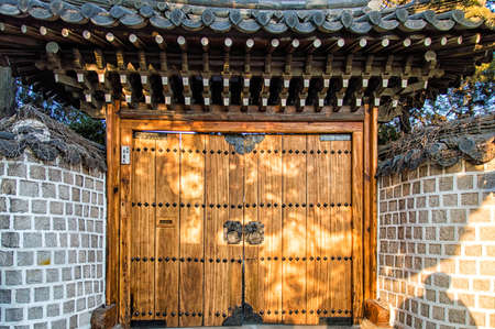 korean style house: Bukchon is a unique and noted place in Seoul, KOREA.Where one can find the trace of traditional life of the ancestors through the Korean traditional houses, alleys and the activities of artisans. Stock Photo