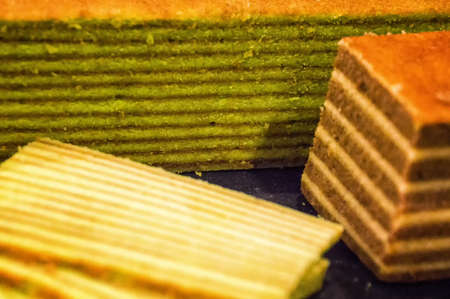 lapis: Traditional Indonesian sweet Lapis layer cake on a wooden background Stock Photo