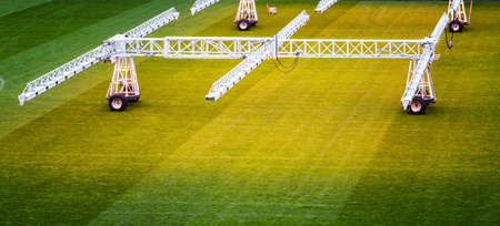 infra red: Maintaining a football field with infra red lamps