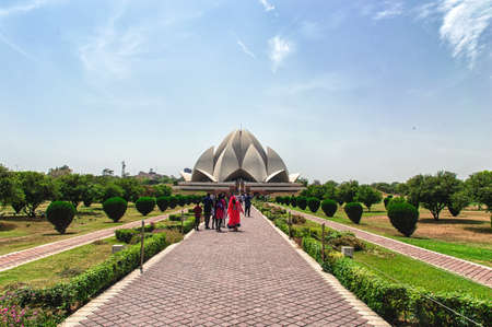 baha: New Delhi, India - April 16, 2016: Visitors at The Lotus Temple, located in New Delhi, India. It is a Bahai House of Worship completed in 1986. Lotus It is open to all people, regardless of religion. Bahai is a monotheistic religion which emphasizes the s