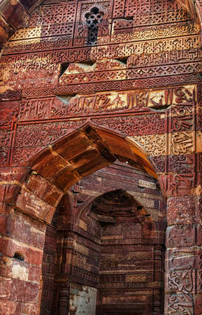 mughal empire: Remains of Qutub mosque in Delhi with sentences from Koran