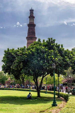 mughal empire: Delhi, India: April 16, 2016: Qutub Minar - the tallest minaret in India, UNESCO World Heritage Site. Qutub Complex, Delhi, India Stock Photo