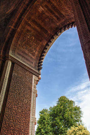 monument in india: Arc Detail from Qutub Minar monument in Delhi, India