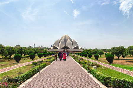 lotus temple: New Delhi, India - April 16, 2016: Visitors at The Lotus Temple, located in New Delhi, India. It is a Bahai House of Worship completed in 1986. Lotus It is open to all people, regardless of religion. Bahai is a monotheistic religion which emphasizes the s