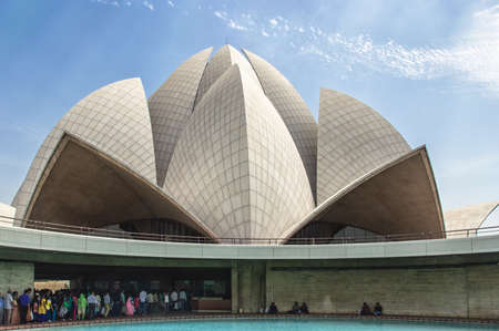 New Delhi, India - April 16, 2016: Visitors at The Lotus Temple, located in New Delhi, India. It is a Bahai House of Worship completed in 1986. Lotus It is open to all people, regardless of religion. Bahai is a monotheistic religion which emphasizes the s