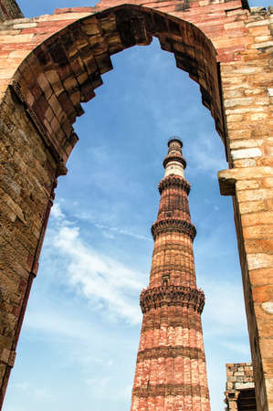 tall chimney: Qutub Minar is a 73 m-high tower of victory, built in 1193 by Qutab-ud-din Aibak immediately after the defeat of Delhis last Hindu kingdom. Qutub Minar is a UNESCO World Heritage Site. Stock Photo