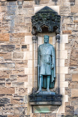 lothian: Edinburgh, Scotland - April 26th 2016. Statue of King Robert the Bruce that stands at the entrance of Edinburgh Castle.