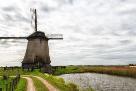 dutch culture: Dutch Windmill along a small canal in polder, The Netherlands