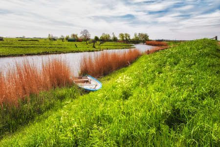 dutch: Dutch landscape with water, reeds clouds