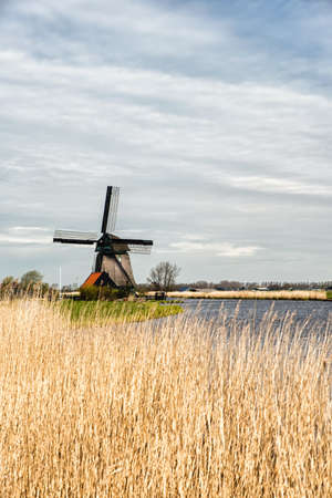 polder: Dutch Windmill along a small canal in polder, The Netherlands