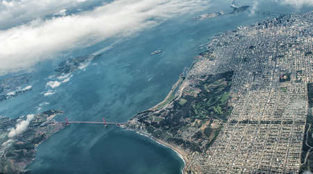 The Famous Golden Gate Bridge and part of San Francisco as  seen from an aircraft window.