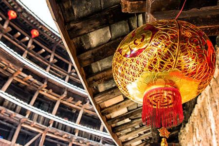 Red Chinese lantern in a Hakka Tulou traditional housing, Fujian