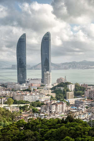 Xiamen new landmark twin towers world trade strait building. because appearance resembles bayonet, was friendly laughed as two swords. the world trade strait building is about 300 meters high, Editorial