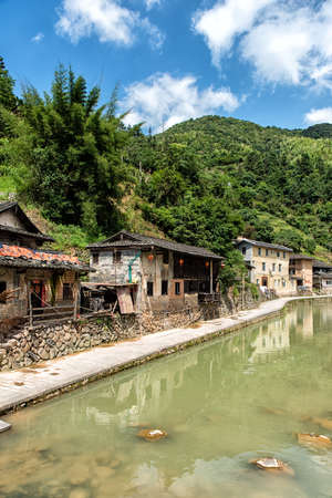 80 years: FUJIAN PROVINCE, CHINA - May 28, 2016: Ancient Taxia village (built in 1426, Ming Dynasty). Its also known as Longeval Village with many inhabitants who older than 80 years