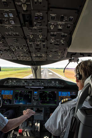 atc: Cockpit view of an airline pilot about to land on final approach Stock Photo