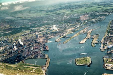 ijmuiden: 22 June 2016, IJmuiden, Netherlands. Aerial view of sluice in the Noordzeekanaal with the factory of steel producer Tata Steel.