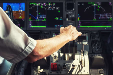 throttle: Pilot Operating the Throttle for Taking Off Stock Photo