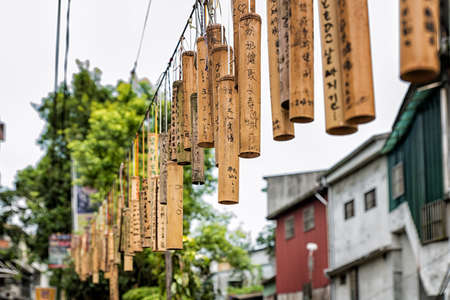 them: PINGXI, TAIWAN - June 24, 2016: Bamboo Tube for Wishing at Pingxi Old Street. Visitors write their wishes on bamboos then pray and hang them together.