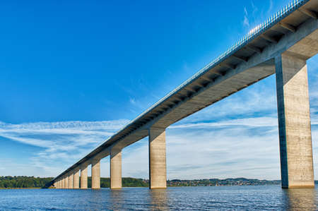 The Vejle Fjord bridge leads traffic outside from the local town, Vejle, and shortens the trip with 10 minutes