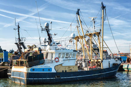 Dutch harbor of Den Oever, Netherlands with modern fishing and trawling boats Editorial