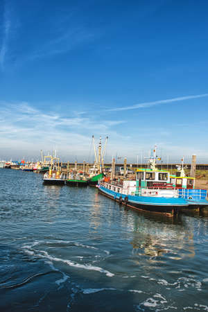 Dutch harbor of Den Oever, Netherlands with modern fishing and trawling boats Stock Photo