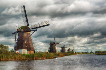 Group of windmills in Kindeijk, Netherlands with nice cloudy sky.
