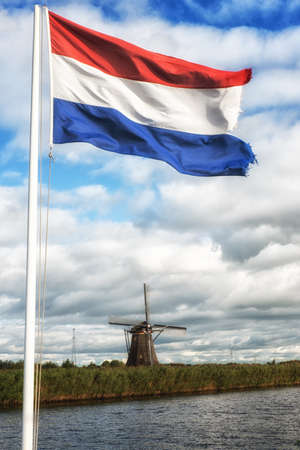 dutch typical: Typical Dutch windmill and national flag Stock Photo
