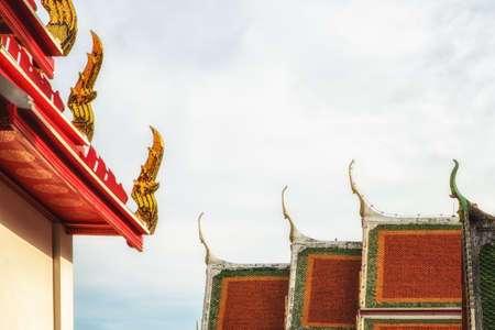 Chofah, literally sky tassel, typical architectural ornamentation on the roofs of Buddhist buildings, Wat Pho, Bangkok Stock Photo