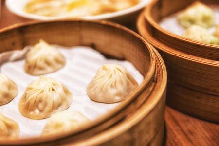 Chinese dumplings or xiao long bao in bamboo tray, famous food in Shanghai, China