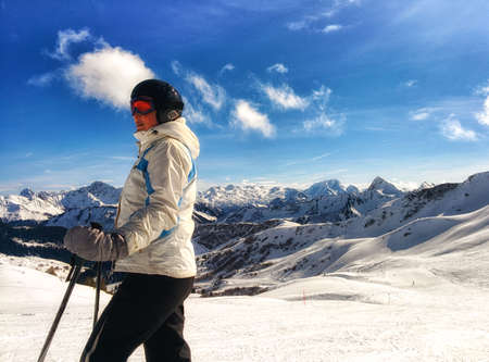 ski walking: Skier posing on a sunny day with mountains and blue sky in the background. Stock Photo