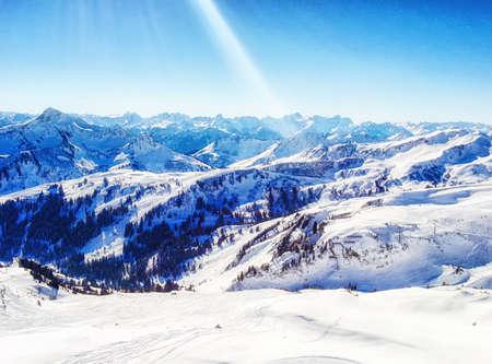 Sunny winter day in alpine ski resort Stock Photo